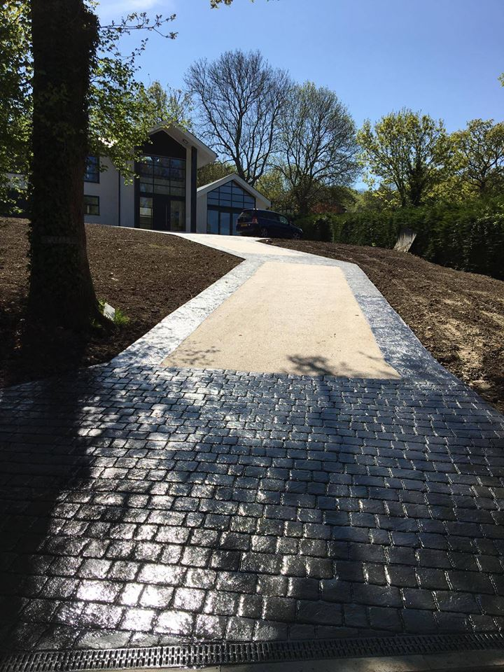Pattern Imprinted Concrete around a resin driveway Surrey