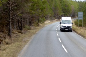 White VW freelance courier van on a country road