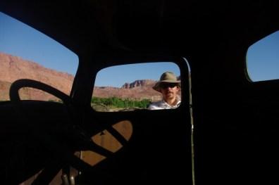 Paul through an abandoned truck.