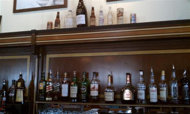 """""""Beers of our Fathers"""" above the bar at Crystal Beer Parlor."""