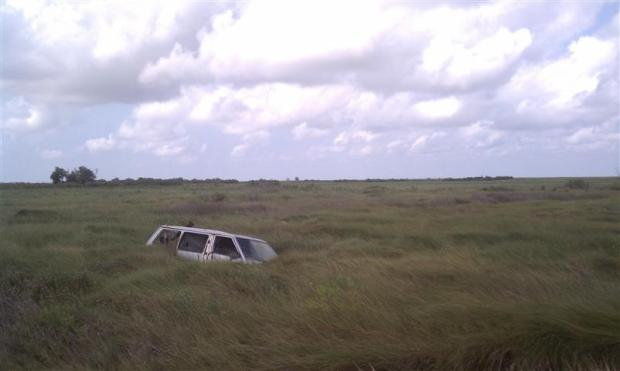 Um, is that a minivan sinking into the salt marsh? Yes.