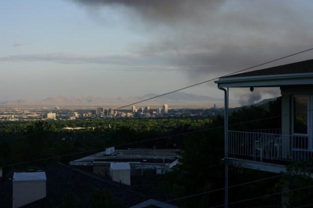 An ominous smoke cloud hung over downtown the next morning.
