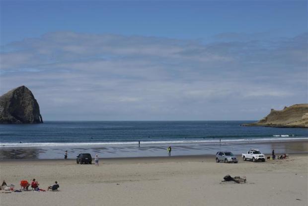Pacific City Dory Beach (Cape Kiwanda Beach). Also popular with surfers, dory watchers, bird watchers, whale watchers, and dune hikers.