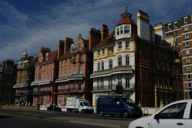 Grand Victorian houses along the shore.