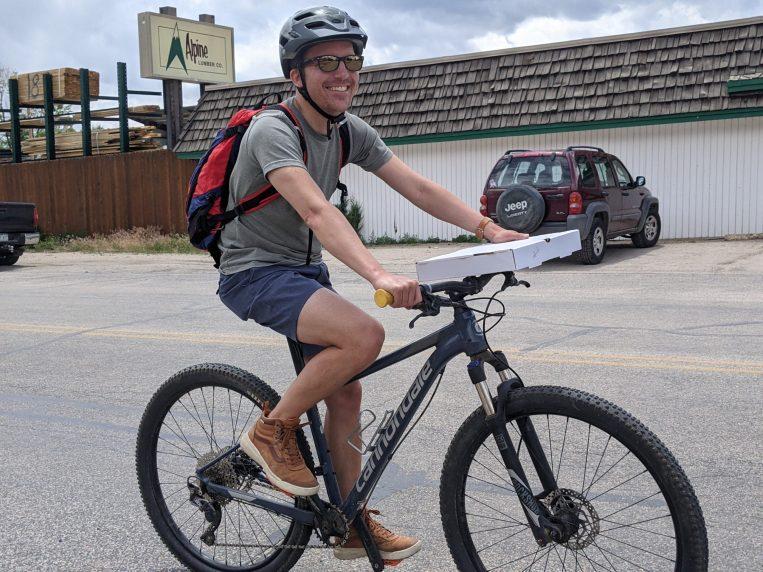 Biking a pizza to camp in Buena Vista.