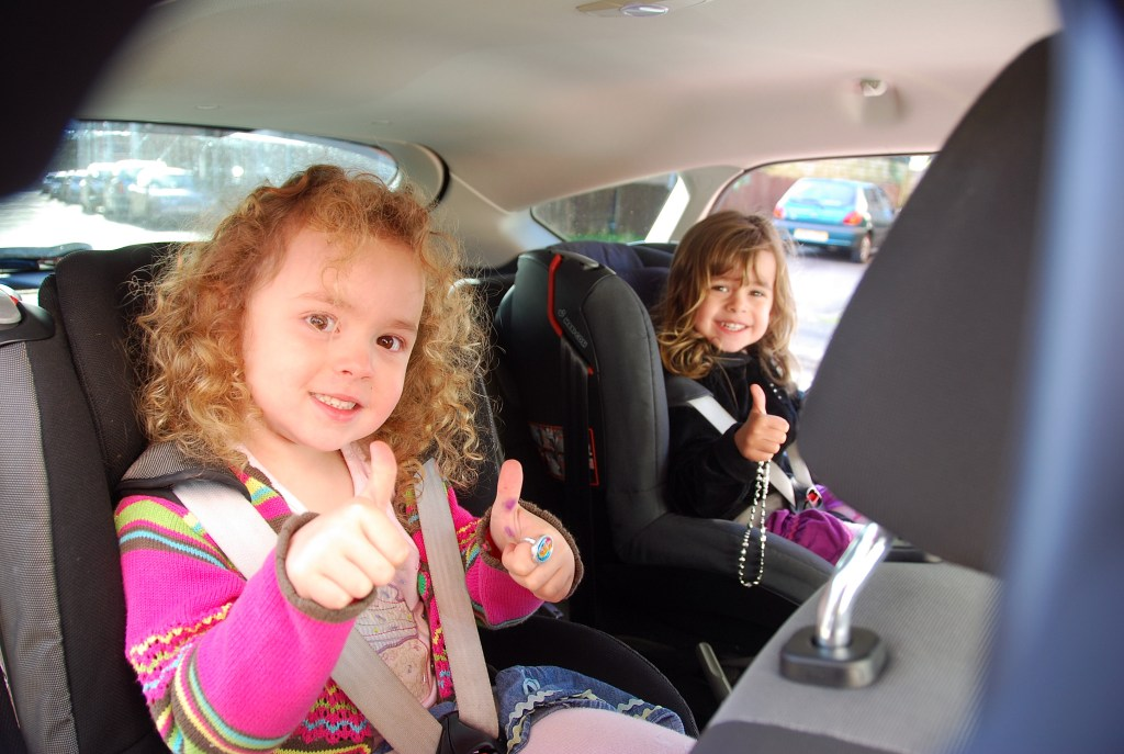 Kids thumbs up in back of focus ecoboost