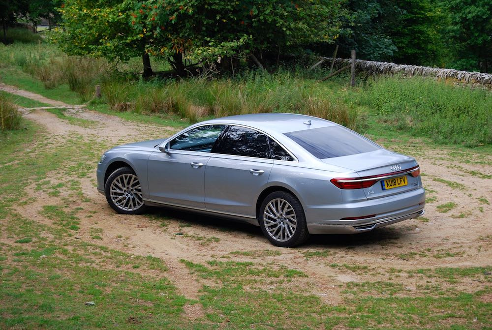 audi a8 review silver rear side