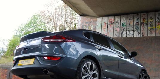 hyundai i30 fastback review grey rear side