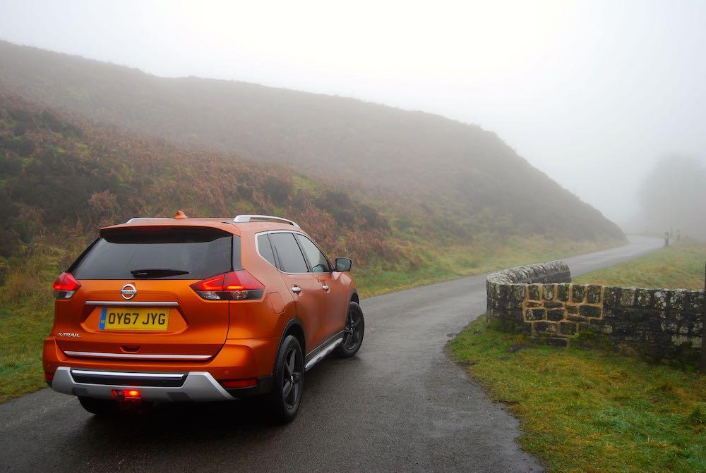 Nissan X-Trail orange rear side review roadtest