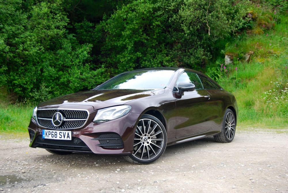 2019 mercedes benz e400d coupe red review roadtest side front