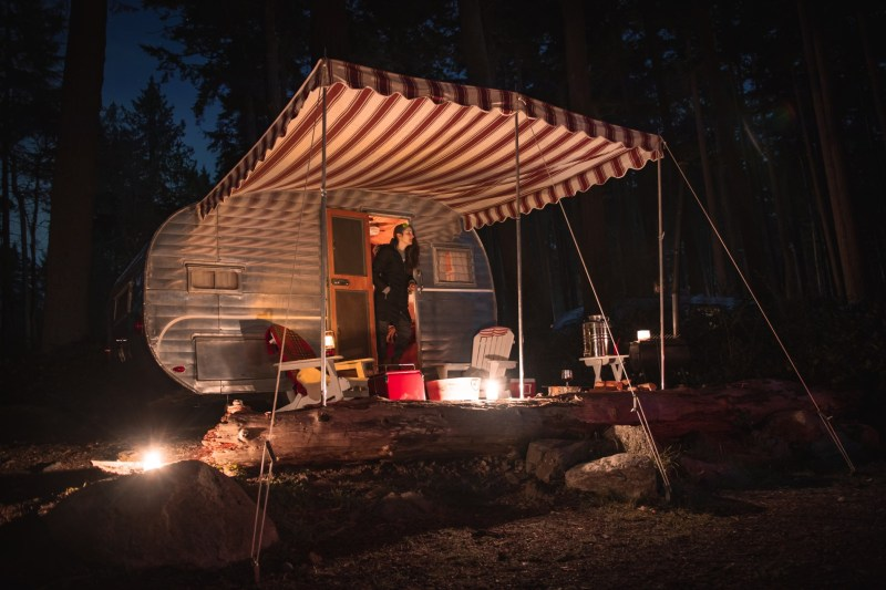 woman-in-the-doorway-of-a-classic-camping-trailer_t20_Jzox8w