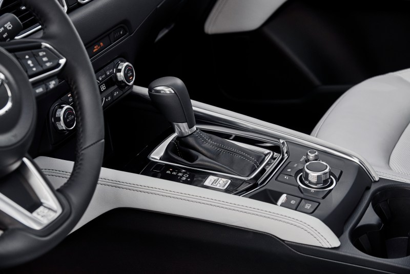 Mazda CX-5 features the layered wood trim, leather-trimmed seats, and premium stitching create one of the most luxurious cockpits in its class.