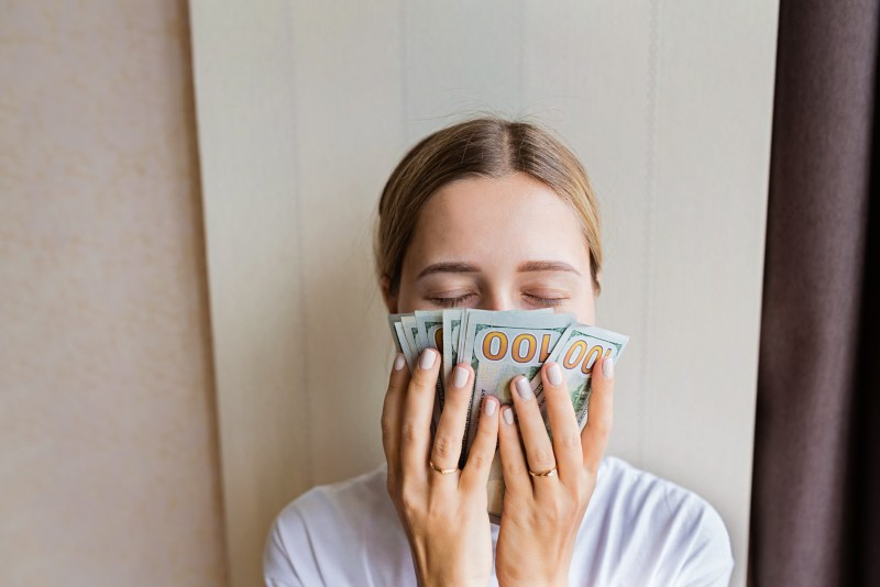 Woman with a stack of money.