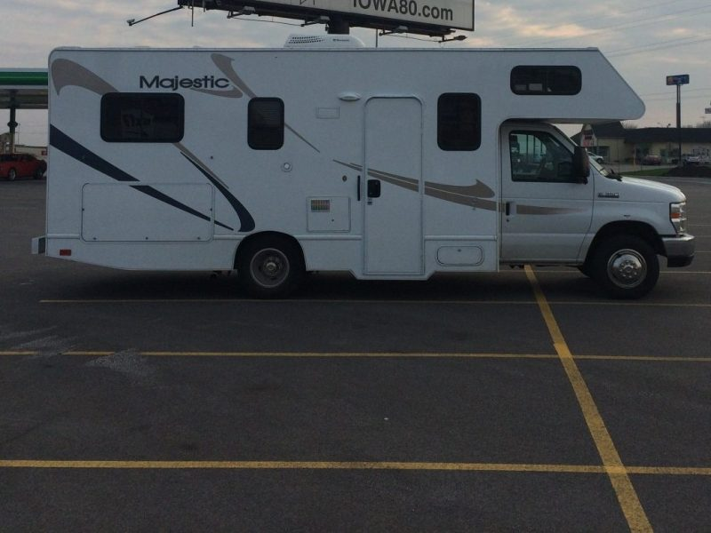 RV parked overnight in an empty lot.