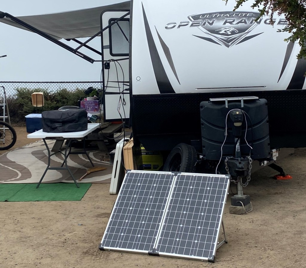 RV parked with solar panels out.