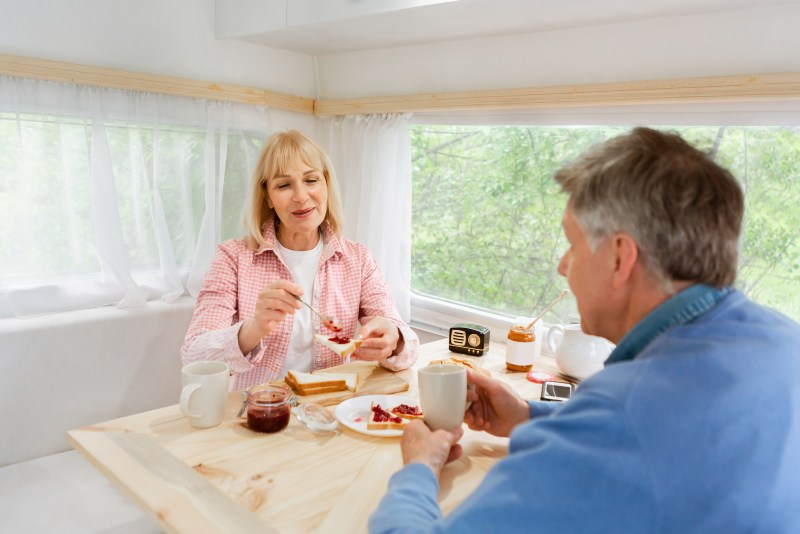 Couple sitting happily in their RV.