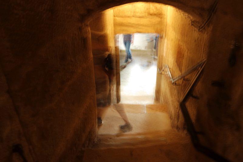 Ghost image walking through a cellar