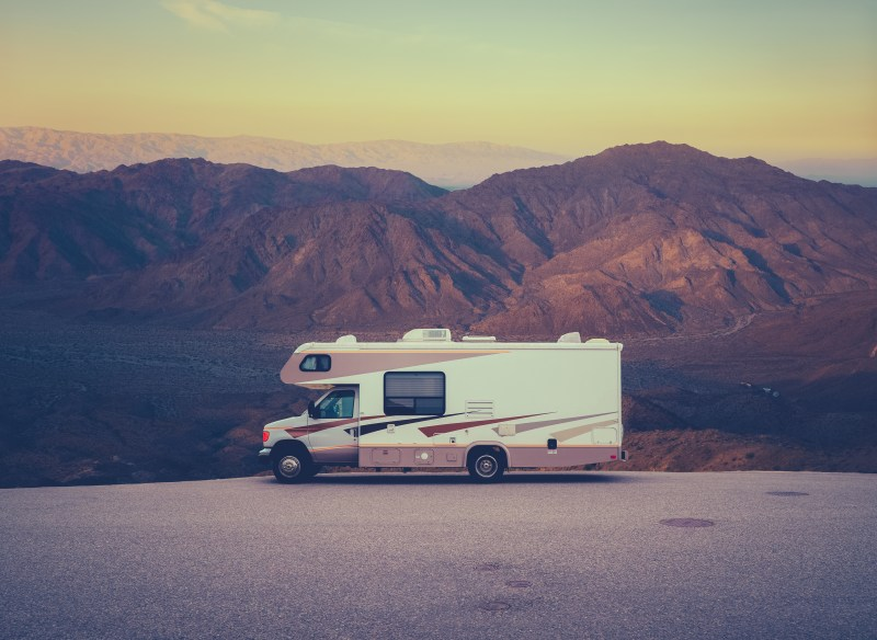 Motorhome parked in front of mountain view.