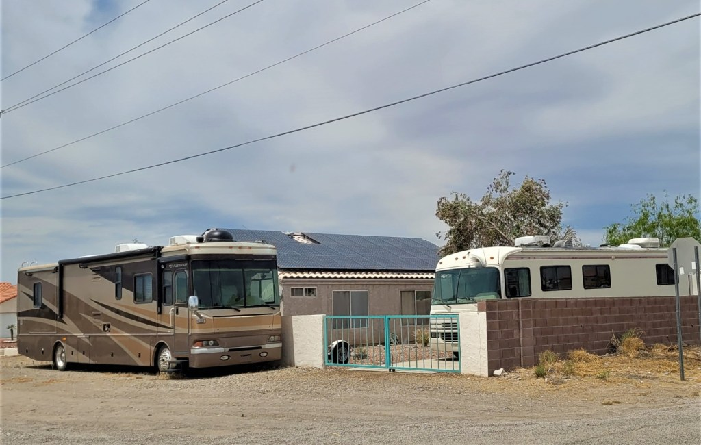 RV parked at friends house in desert.