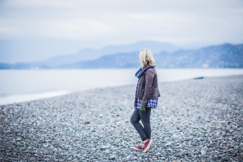 Woman looking out at ocean from Alaska.