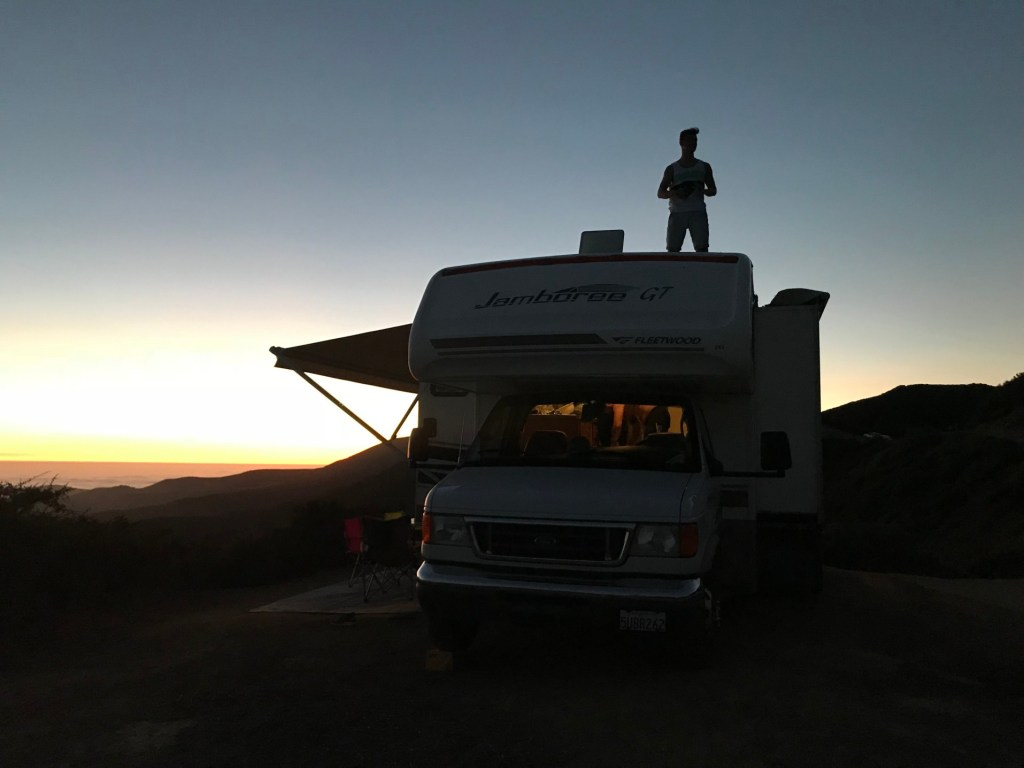 RV trailer parked at sunset.