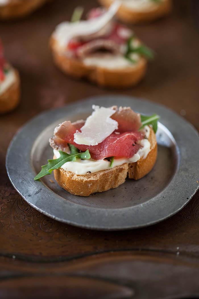 carpaccio of beef on a crostini with cheats aioli