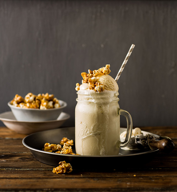 cereal milk milkshake with caramel corn and cornflake clusters