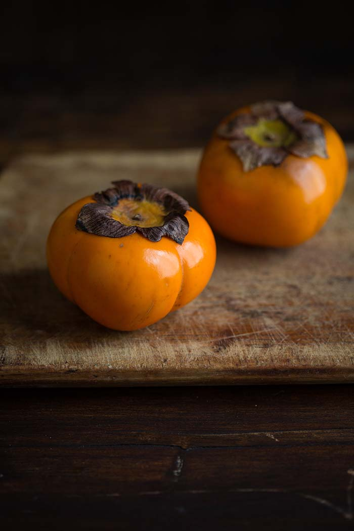 persimmons for a delicious salad with kohlrabi, hazelnut, mint and Parmesan