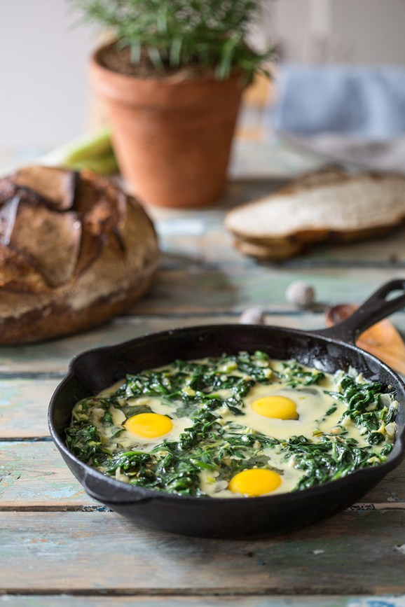 eggs baked in creamy spinach