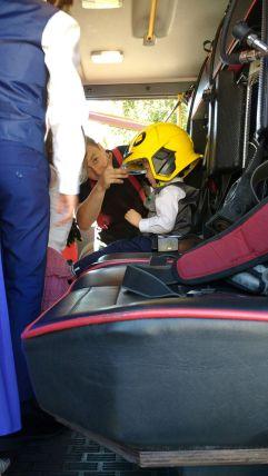Wearing a firemans helmet