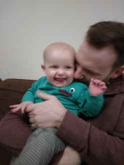 Giggling from raspberry blowing Daddy