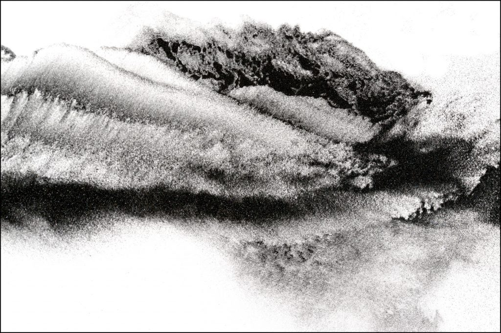 Abstract photograph of black sand