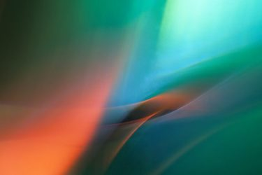 Abstract photograph of blue green orange light, taken for healing by a medical doctor