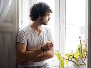 Individual looking out the window - emotional health
