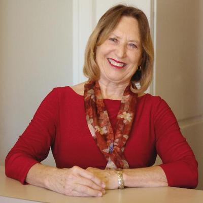 Dr. Karen Gless smiling in her office