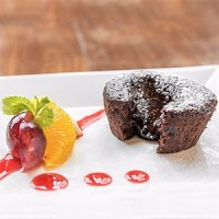 Chokoladekage med flydende midte lava chokolade kage blødende flyder ud blød i midten moelleux chokolat opskrift