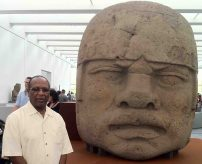 "Dr. Kwaku with an Olmec Head. He calls it ""Brothers."""