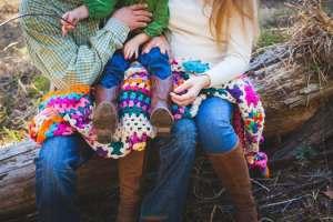 parents holding child on lap