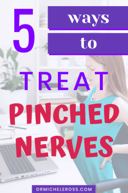 woman with pinched nerve sitting at office desk in pain