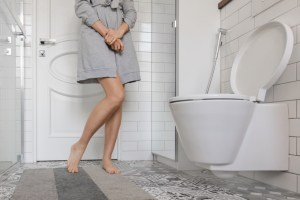 woman with urological issue in the bathroom