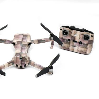 Metallic Rivets Strikes Drone Skin Wrap Decal Stickers for DJI Mavic Air 2 Applied to Drone and Remote Rear View