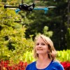 This is Mary 'Missy' Cummings standing with a hovering drone in the Sarah P. Duke Gardens at Duke University, where she will work to generate a set of inexpensive, unobtrusive best practices to deter unwanted drone usage.