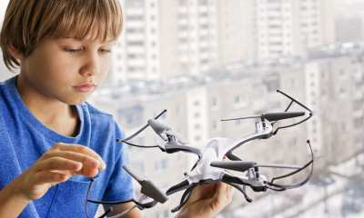 A child playing with a drone.
