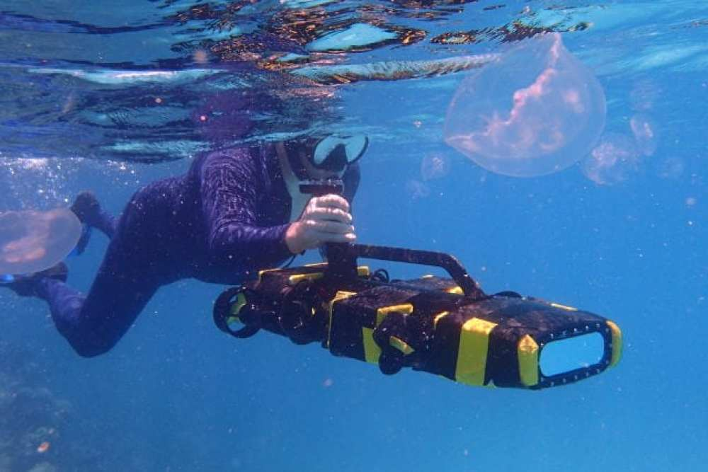 QUT's Dr Matt Dunbabin puts a RangerBot to the test on the Great Barrier Reef