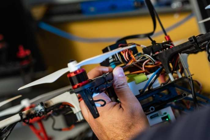 Rice University postdoctoral researcher Riccardo Petrolo adjusts a drone in preparation for testing.