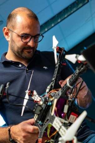 Postdoctoral researcher Riccardo Petrolo adjusts a gas-sensing drone in a Rice University laboratory.