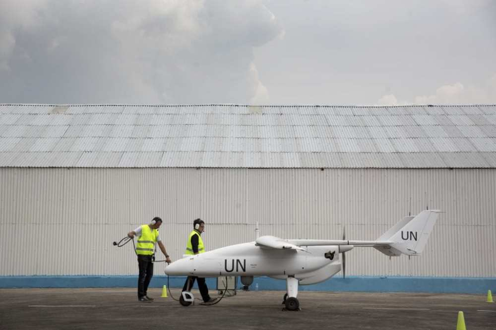 MONUSCO Photos A team of technicians prepares for the inaugural flight of an Unmanned/Unarmed Aerial Vehicles (UAV) in Goma, North Kivu province, during an official ceremony organized in the presence of USG for Peacekeeping Operations, Herve Ladsous, on 3 December 2013.