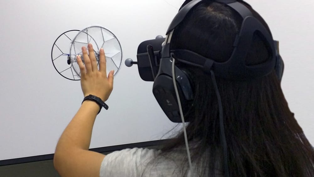 Participant exploring the virtual balloon during the first user study through touching and pushing.