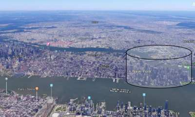‡e perimeter of the black cylinder de€nes a geofence for the €nan- cial district of Manhattan, NYC.