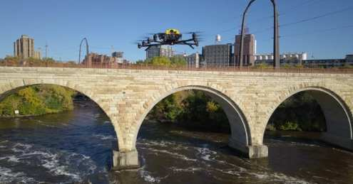 The Intel Falcon 8+ drone conducts a visual inspection of the historic Stone Arch Bridge in Minneapolis. Working with the Minnesota Department of Transportation and Collins Engineers, Intel used its commercial drone technology to help automate and expedite inspection of the pedestrian and bicycle bridge. (Credit: Intel Corporation)